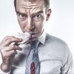 man eating food